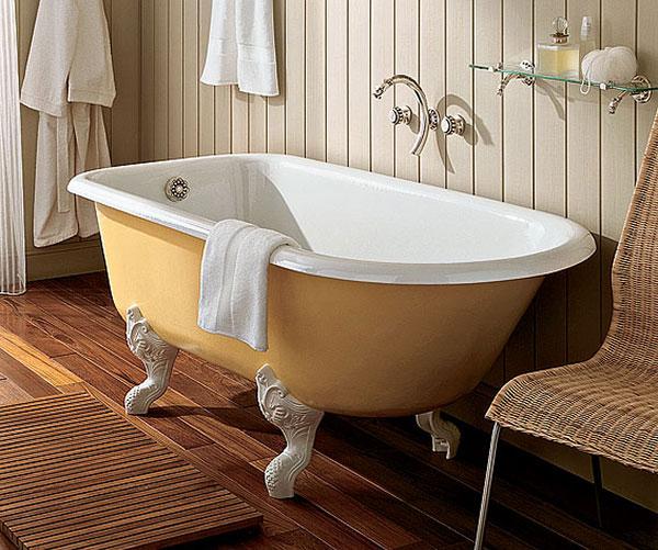 Симпотная ванна из чугуна: жёлтая на ножках