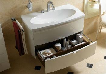 Если размеры умывальников для ванной комнаты с тумбой довольно большие и есть дополнительные ящички, то в них можно хранить белье, полотенце, косметику и прочее